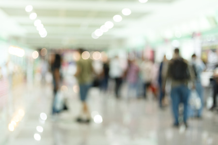 census: crowd people traveler in airport terminal, image blur used background