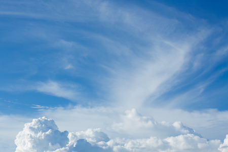 overcast: cloud floating above clear blue sky background