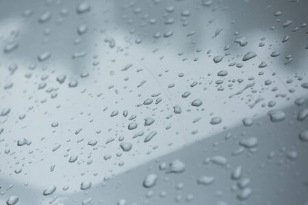 polisher: rain drops on car with glass coating protection skin