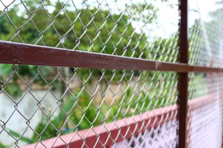 chainlink fence: chain link wire fences enclose border area