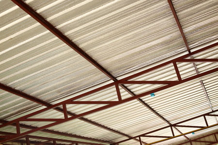 attic: silver foil insulation heat on ceiling roof house Stock Photo