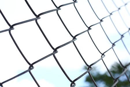 wire mesh: chain link wire fences enclose border area