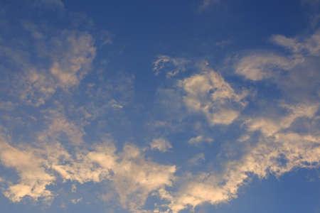 skylight: beautiful clear blue sky with golden sunshine on fluffy cloud