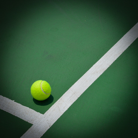 old items: tennis ball on green court, sport background