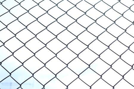 metal grid: chain link wire fences enclose border area