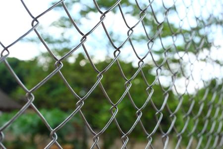 chain link wire fences enclose border area