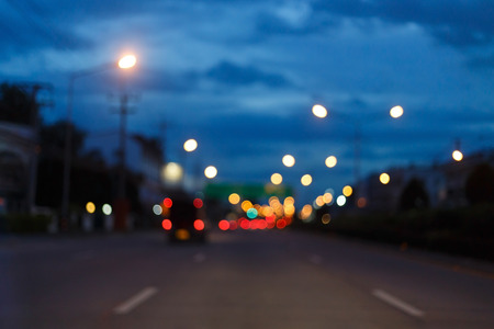 night light of traffic car on the city street, abstract blur bokeh background Stock Photo