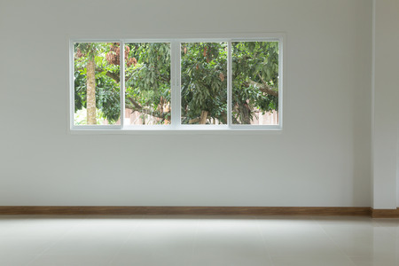Empty room with glass window sliding on white wall and tile floor