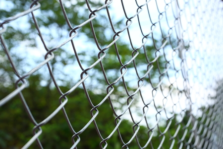 chain link wire fences enclose border area