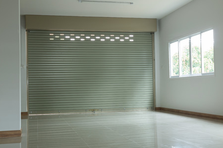 warehouse building: empty room in house residential building with aluminium roller shutter door and window glass sliding and white flooring tile