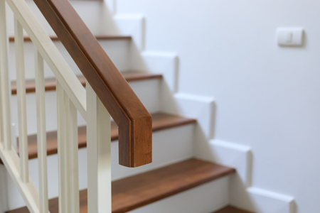 Brown Wood Banister On Staircase Interior Design Of White Modern House  Stock Photo   83228172