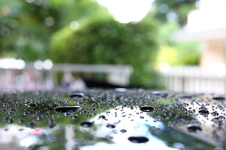 water rain droplet on black car with glass coating skin