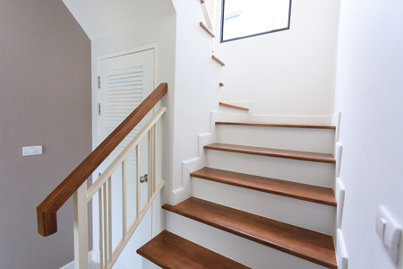 inside contemporary white modern house with wood staircase Stock Photo