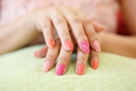 beautiful pink fingernail manicure acrylic nail polish of woman hand beauty fashion