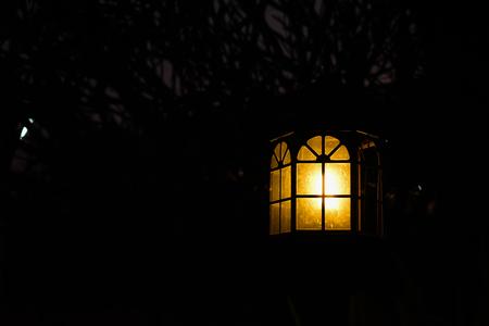 lamp light in night garden Stock Photo