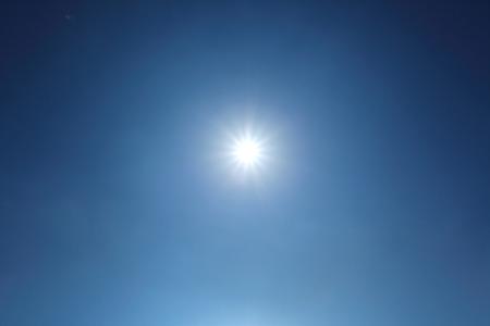 sun on clear blue sky weather background, light rays solar of clean energy power Reklamní fotografie