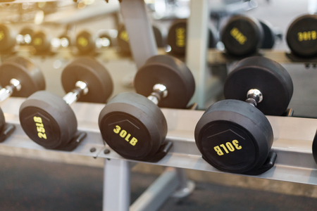 dumbbell in fitness gym, equipment for muscle bodybuilding healthy lifestyle 版權商用圖片