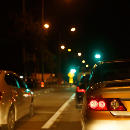 tail light of back car on night urban street road