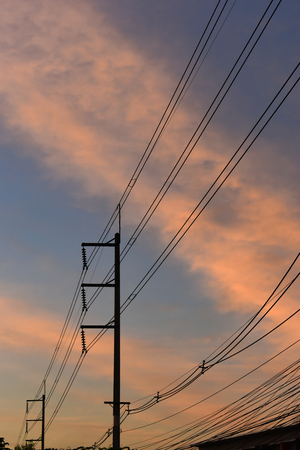 pylon electricity power line with sunset sky background Archivio Fotografico