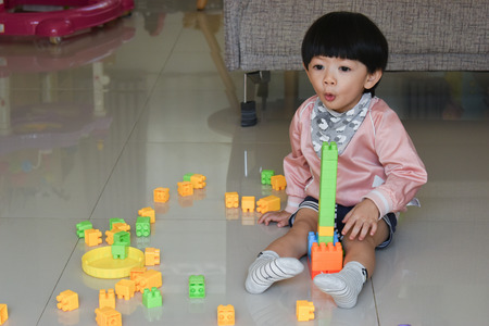 cute boy playing block toy creative learning and using small muscle of baby finger hand