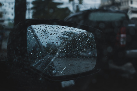 car driving on road with storm of rainy day Фото со стока