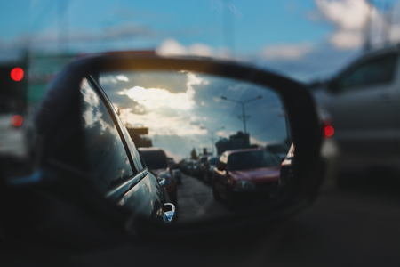 vehicle car travel road trips at town with twilight sky view on sideview of mirror Фото со стока
