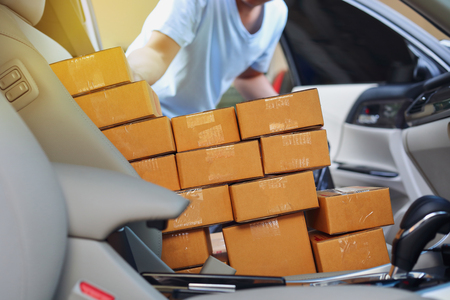 businessman service delivery goods express, mamy paper box post package in car 写真素材