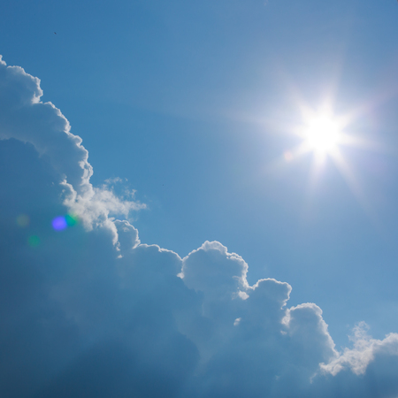 hot summer sun on clear blue sky with cloud 写真素材
