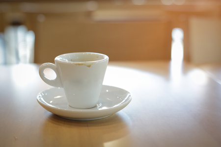 white coffee cup on wooden table Stock Photo