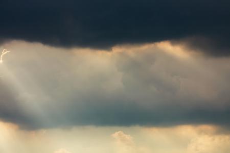 sunlight through cloud on dramatic sky after the rain