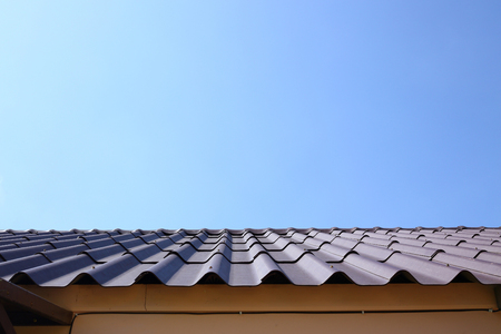 black roof tile top on residential house Stock Photo