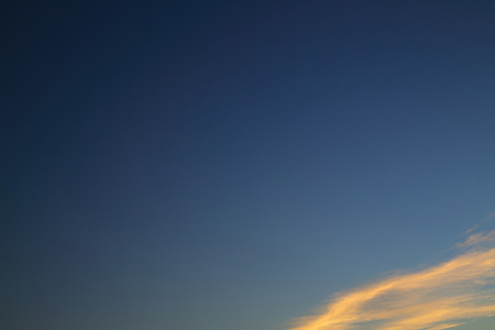 evening clear blue sky with orange sunlight shine through cloud Stock Photo