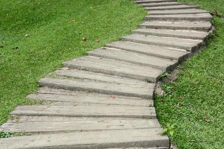 garden path walkway on green grass turf