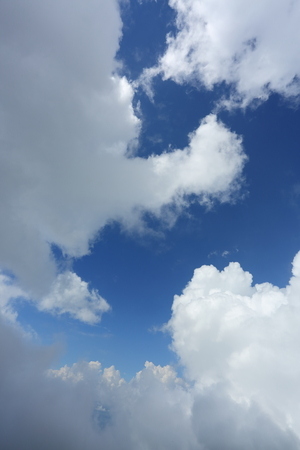 fluffy white cloud moving above dream sky background