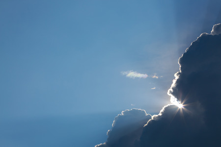 sun light shine through cloud on clear blue sky background