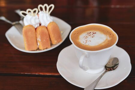 espresso hot coffee drink and orange cake put on breakfast table in the morning Reklamní fotografie