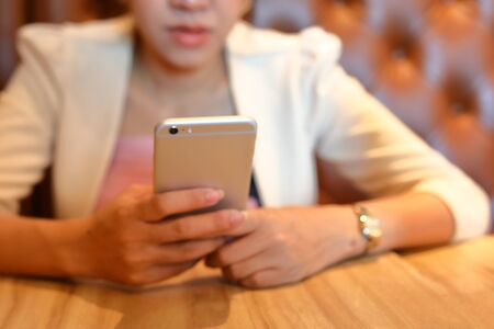 woman using mobile phone, image blurry used for business background Stock Photo
