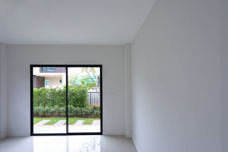 empty white wall interior room with slide door in new residential house