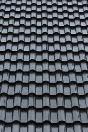 rainstorm downpour on black roof tile of residential house