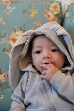 little baby wearing warm clothing bunny suit