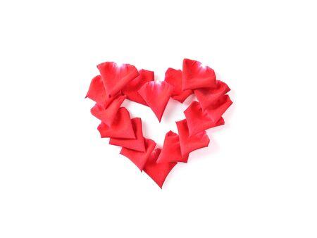 red heart shape of rose petal flower isolated on white background, image romantic love symbol Banco de Imagens - 137894260