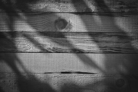 dark wood barn wall plank texture background with light shiny in night, top view of old wooden table, image black and white monochrome tone Banco de Imagens