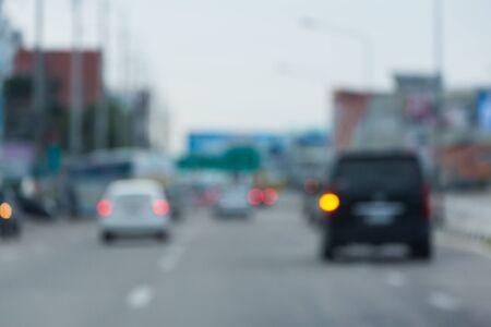 car driving on urban road trip travel, image blur background
