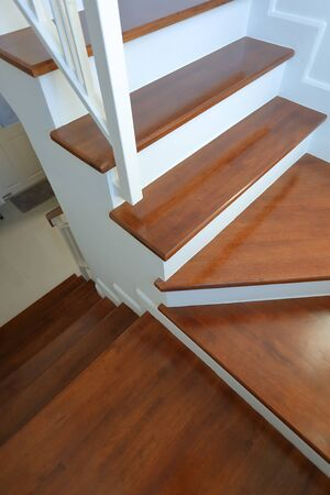 brown wooden hardwood stair in modern residential house Stock Photo