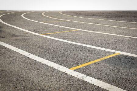 black tarmac asphalt of running track, athletic sport background 版權商用圖片
