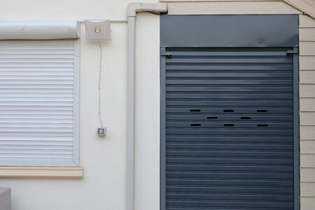 black roller shutter door closed security in house