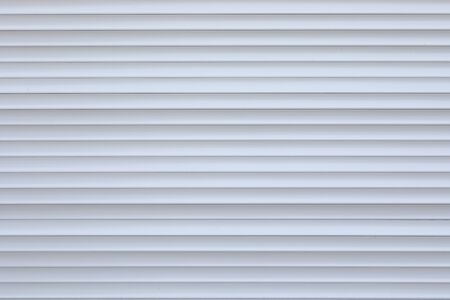 white roller shutter door closed security in modern house