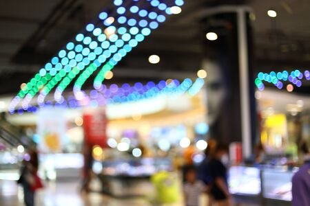 abstract blur background image of business shopping mall department store with colorful light interior decoration