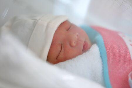 cute little newborn baby sleeping sweet dream in soft blanket