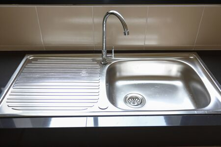 water faucet closed and empty stainless sink cooking in kitchen room